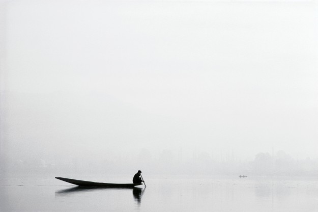 Silhoutted Boater in Fog