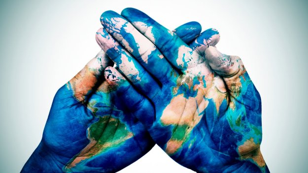 050887590-man-hands-patterned-world-map-